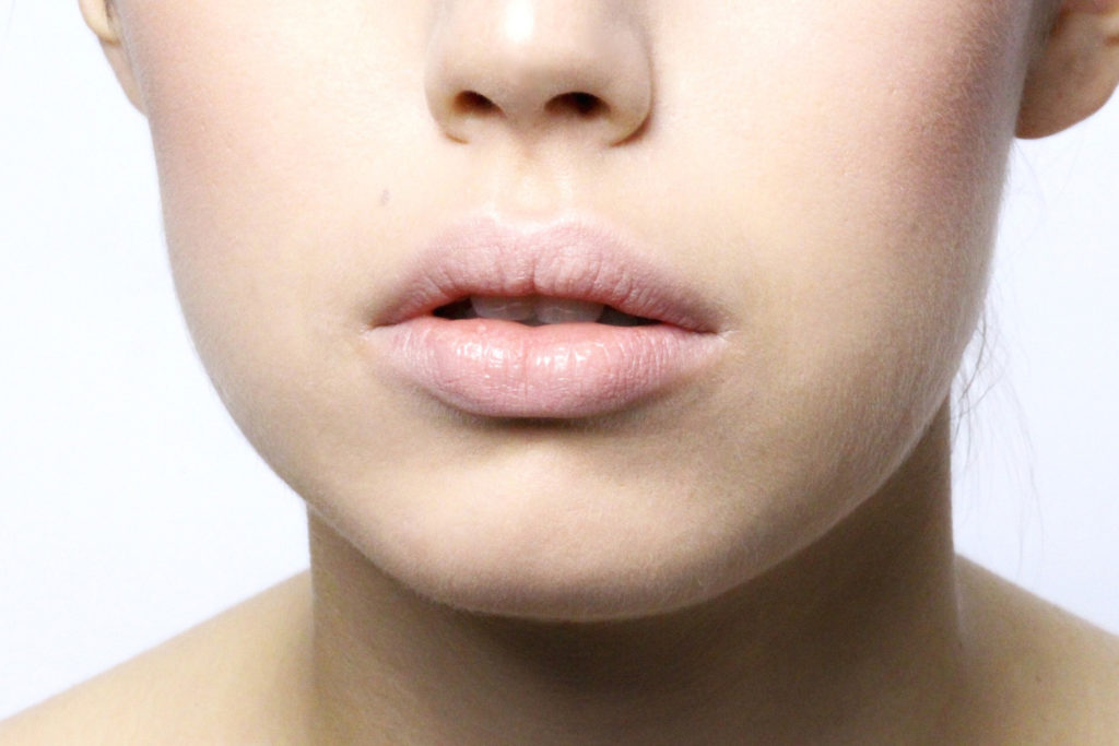 Moisturize your lip and apply concealer before adding any color